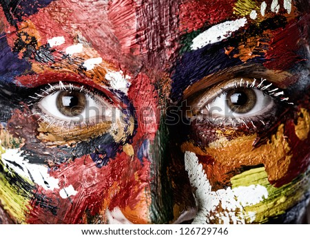 A colored woman's face in oil paints - stock photo