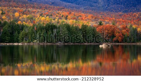 A Colorful And Pastoral Mountain Lake Scene On An Autumn Evening, Loon Lake, Adirondack Mountains, New York State, USA - stock photo