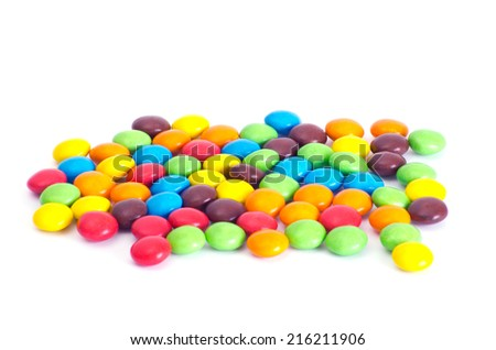 A colorful assortment of shiny round gumballs. - stock photo