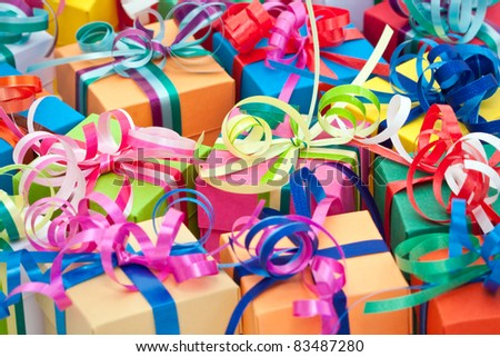 A colorful assortment of small gifts tied with bows.