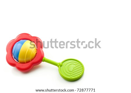 A colorful baby rattle on a white horizontal background