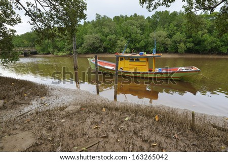 a colorful boat are docked at the river mouth
