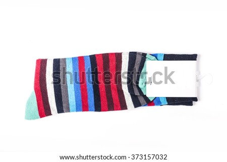 A colorful cotton socks with empty(blank) label, stripes on the bottom isolated white.  - stock photo