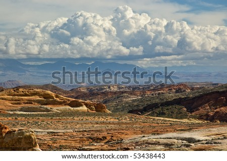 A colorful desert and dramatic clouds in Valley of Fire State Park, Nevada - stock photo