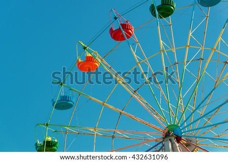 A colorful Ferris Wheel on the background of blue sky - stock photo