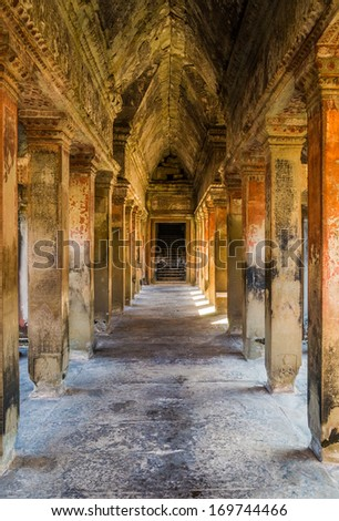 A colorful gallery way at the ancient temple of Angkor Wat in Cambodia - stock photo