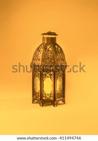 A colorful graphic design of a ramadan lantern. 'Ramadan Kareem' - A  graphic greeting card cover. - stock photo