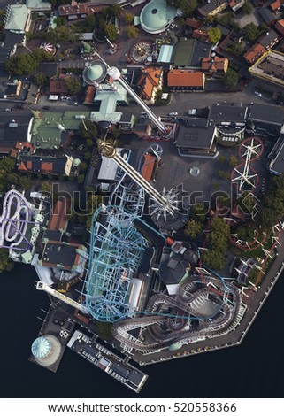 A Colorful Looping Roller Coaster On A Beautiful Sunny Day in Stockholm, Sweden.