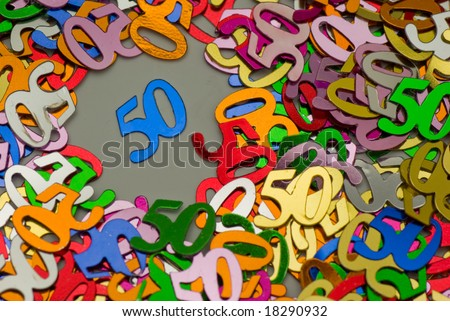 A colorful picture of confetti in the shape of the nr. fifty