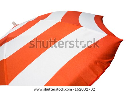 a colorful striped beach umbrella isolated on a white background - stock photo