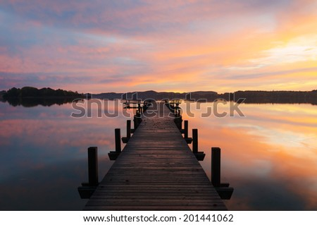 A colorful sunrise at lake Woerthsee in Bavaria, Germany - stock photo