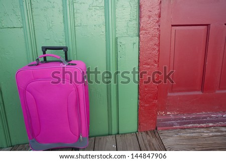 A colorful travel suitcase ready for a vacation.