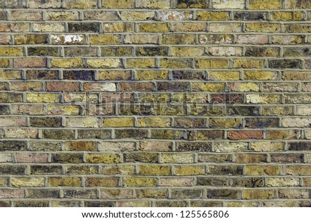 A colorful Victorian brick wall in London - stock photo