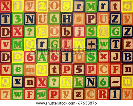 A colorful wall of lettered blocks for a background - stock photo