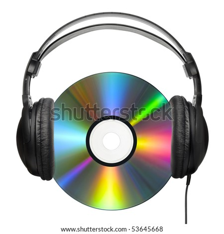 A colorfully reflecting CD with professional headphones put on it - stock photo