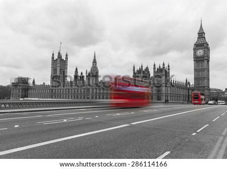 A colormix of Westminster showing bright red buses on a black and white image of Westminster. - stock photo