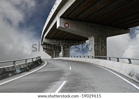 A colossal concrete motorway flyover access and egress. - stock photo