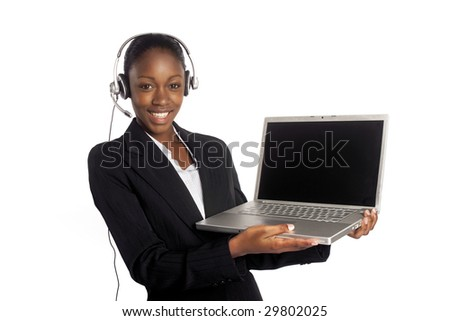 A coloured worker presenting on a laptop - stock photo