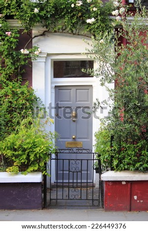 A colourful british style squared front door - stock photo