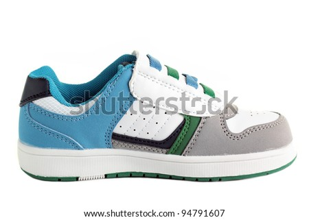 A colourful kids casual shoe, isolated on a white background. - stock photo