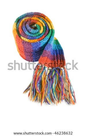 A colourful rainbow scarf curled up into a ball, isolated on white - stock photo