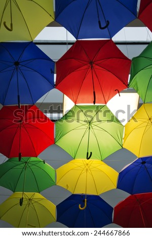 A comercial area decorated with umbrellas. - stock photo