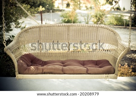 a comfortable swing bench at a honeymoon location - stock photo