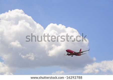 A commercial passenger plane in its descent to land. - stock photo