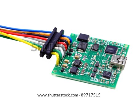 A common green integrated circuit (IC) board and surface mount technology isolated on white - stock photo