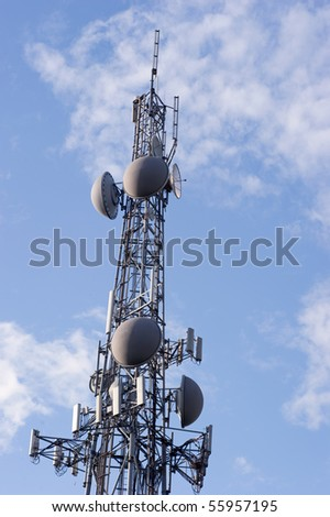 a communication tower reaches into the skies