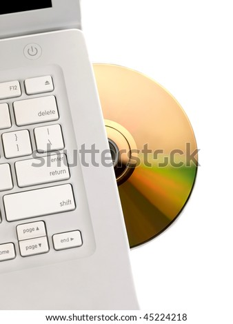 A compact disk being inserted into the media drive - stock photo