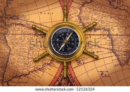 Compass on old world map background imagen de archivo stock a compass on a old world map background compass gumiabroncs Gallery