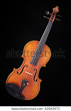 A complete violin viola isolated against a black back ground with copy space. - stock photo