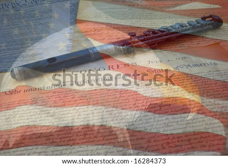 A composite of two photos taken by the author - bald eagle, American flag, Declaration of Independence and Constitution with fife combined into one photo. - stock photo