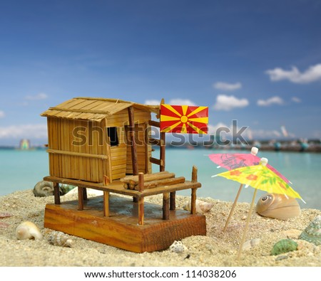 A composite photo with characteristic fisherman house maquette from Dojran, Macedonia - stock photo