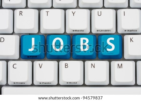 A computer keyboard with blue keys spelling jobs, Applying for jobs on the internet - stock photo