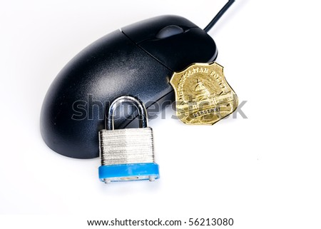 A computer mouse with a lock and policeman's badge symbolizing internet security - stock photo