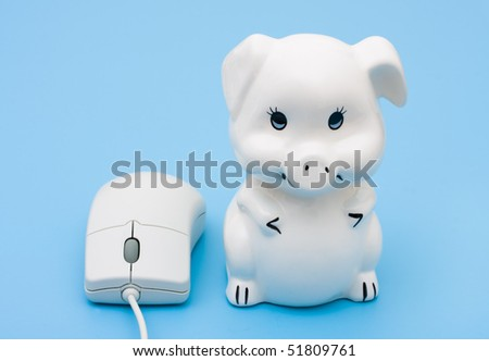 A computer mouse with a piggy bank on a blue background, internet banking