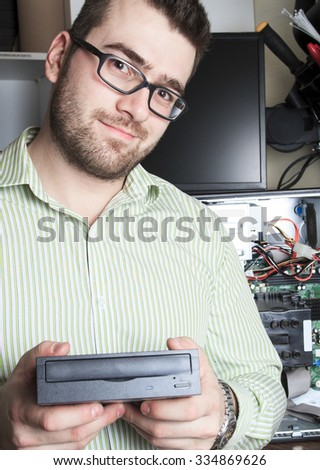 A computer technician at work. - stock photo