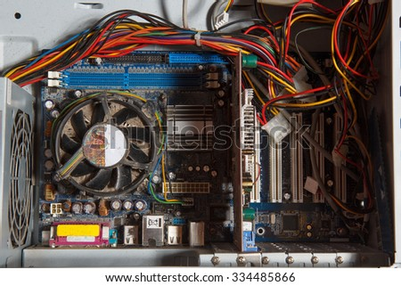 A computer with its wiring and components exposed - stock photo