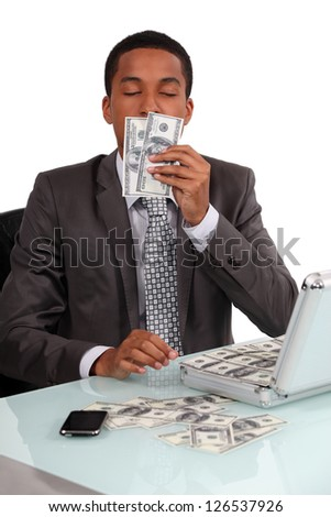 A con man smelling his loot - stock photo