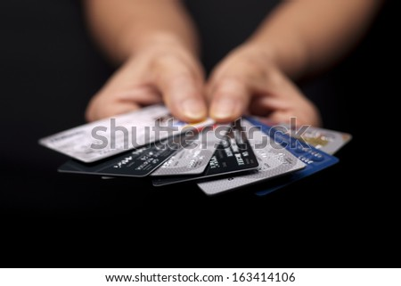A concept image of credit cards fanned out to pick one. - stock photo