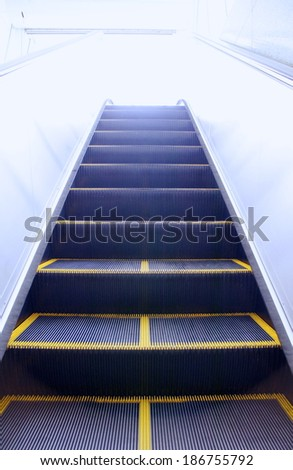 A concept image of  escalator going to the heaven - stock photo