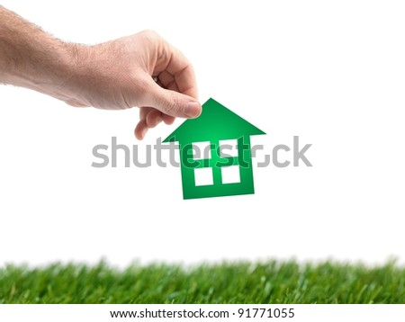 A conceptual house image held by a hand - stock photo