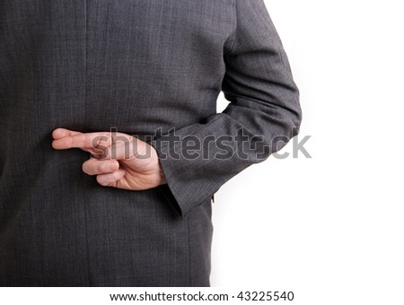 A conceptual image of a business man with his fingers crossed behind his back. - stock photo