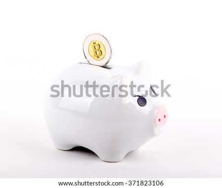 A conceptual image of Bitcoin, a popular virtual currency, deposited into a piggy bank.