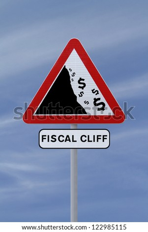 A conceptual road sign on the US fiscal cliff (against a blue sky background)