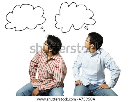 A conceptual shot of two businessmen looking at their own thoughts - stock photo
