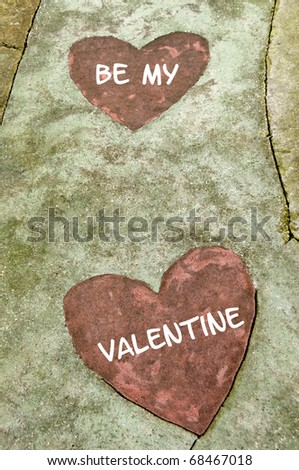 """A concrete path with two hearts on it with the message, """"Be My Valentine"""". - stock photo"""