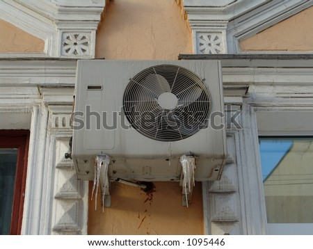 A conditioner with icicles - stock photo
